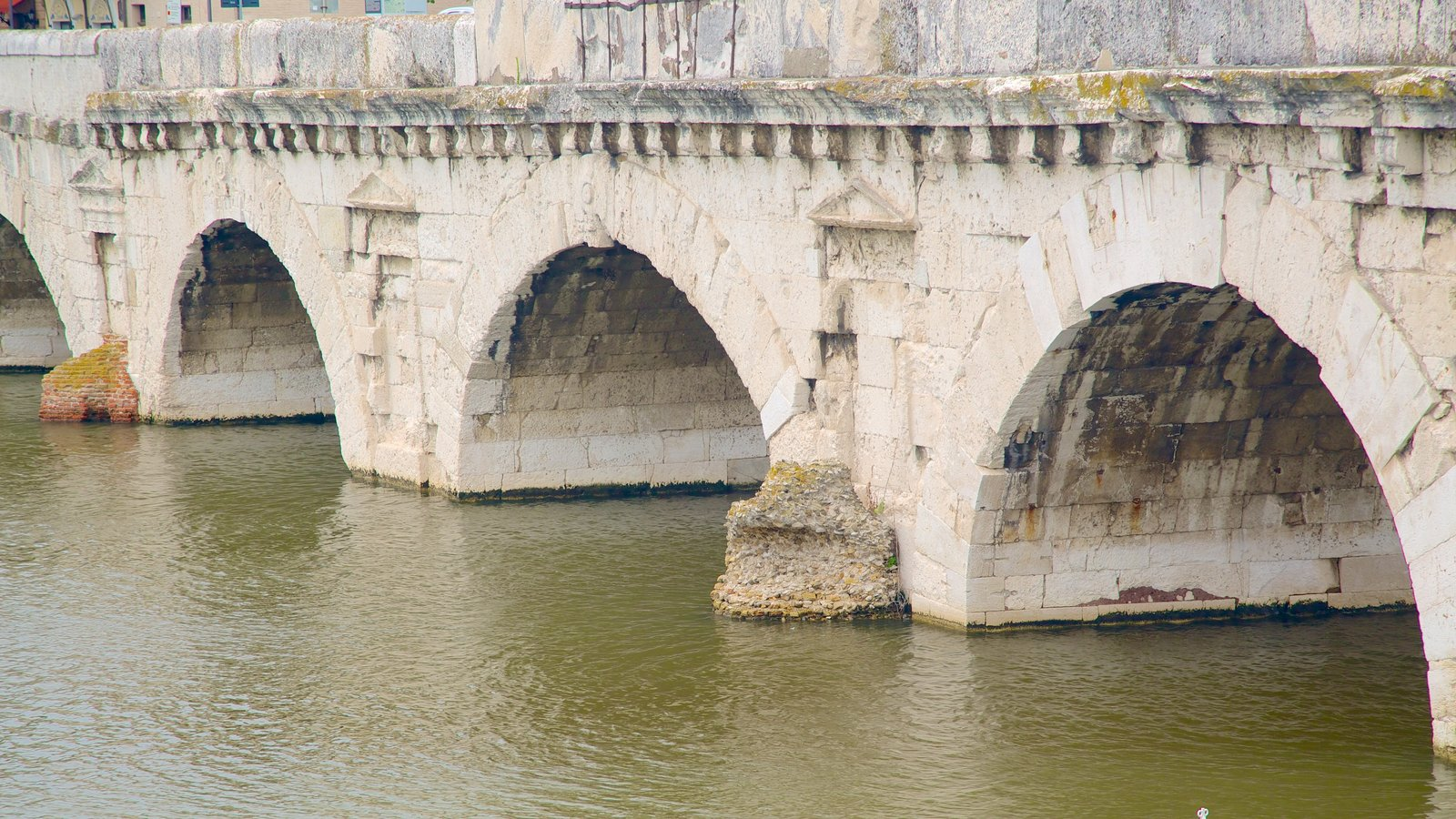 Tiberius Bridge showing heritage architecture, a bridge and a river or creek