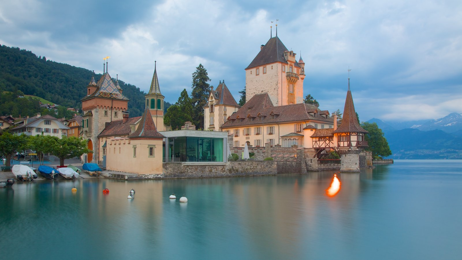 Interlaken showing a lake or waterhole, château or palace and heritage architecture