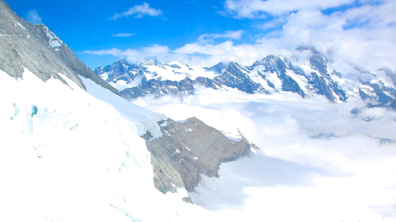 Jungfraujoch featuring snow, mist or fog and mountains