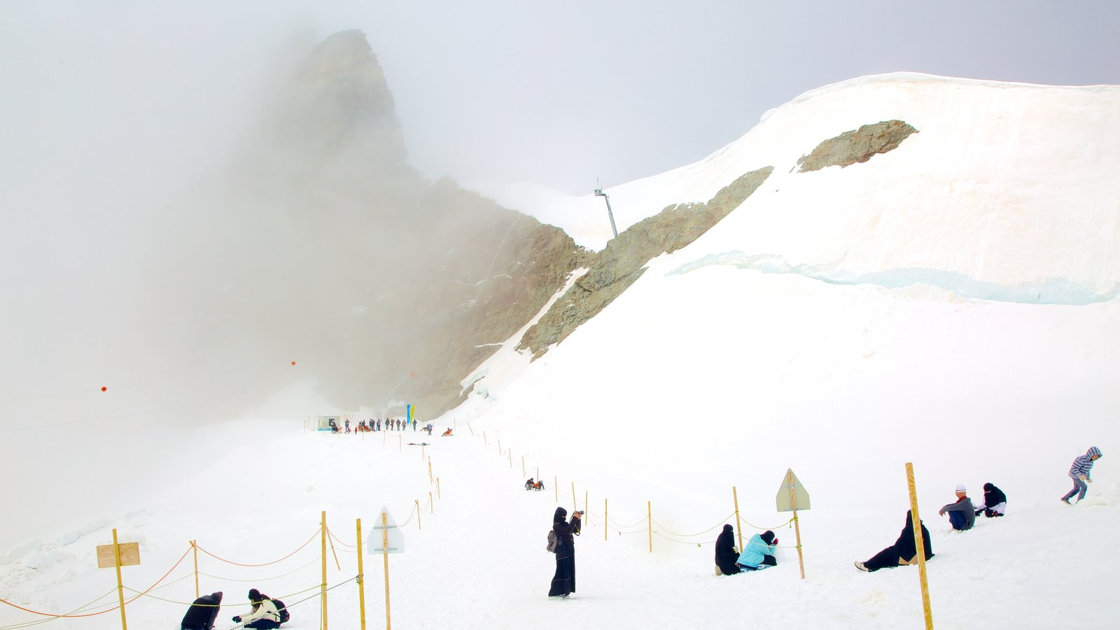 Jungfraujoch which includes snow and mountains as well as a large group of people
