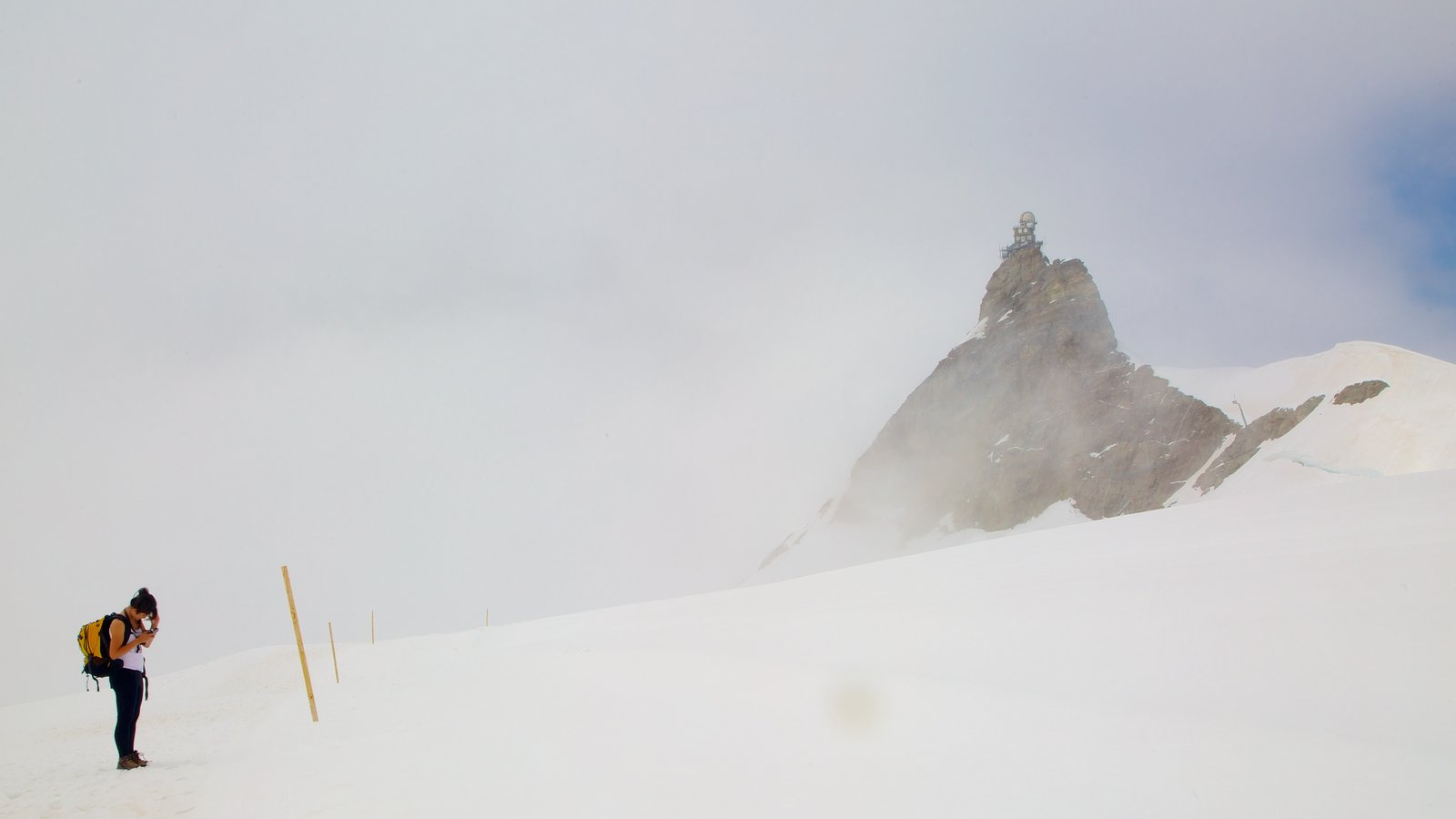 Jungfraujoch featuring mist or fog, hiking or walking and mountains