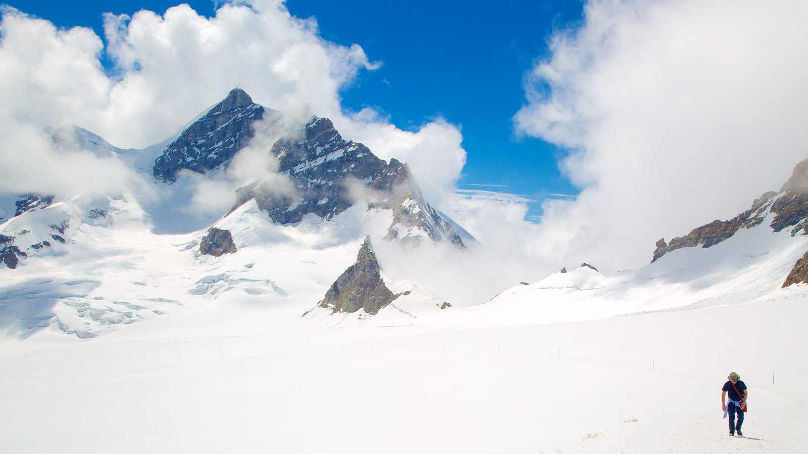 Jungfraujoch featuring snow, mist or fog and hiking or walking