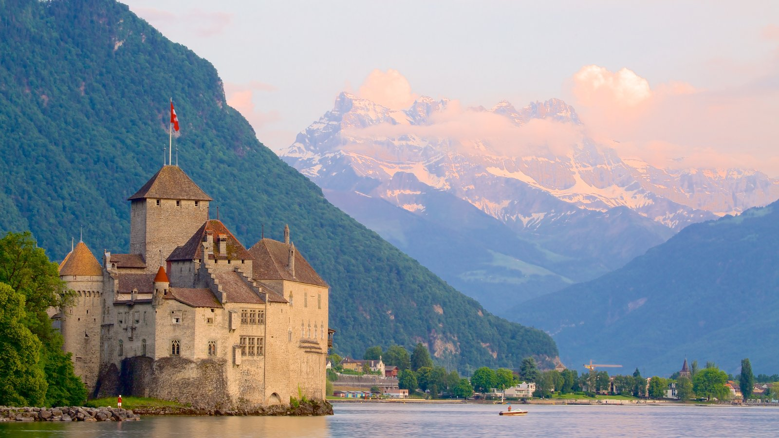 Chateau de Chillon which includes a castle, a lake or waterhole and mountains