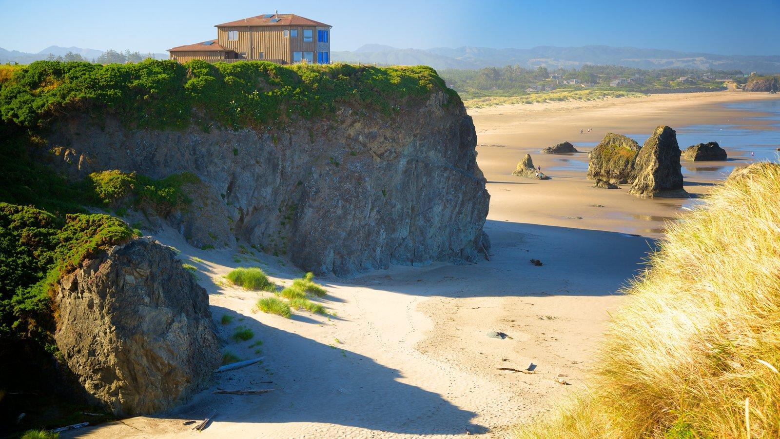 Bandon mostrando uma casa e uma praia