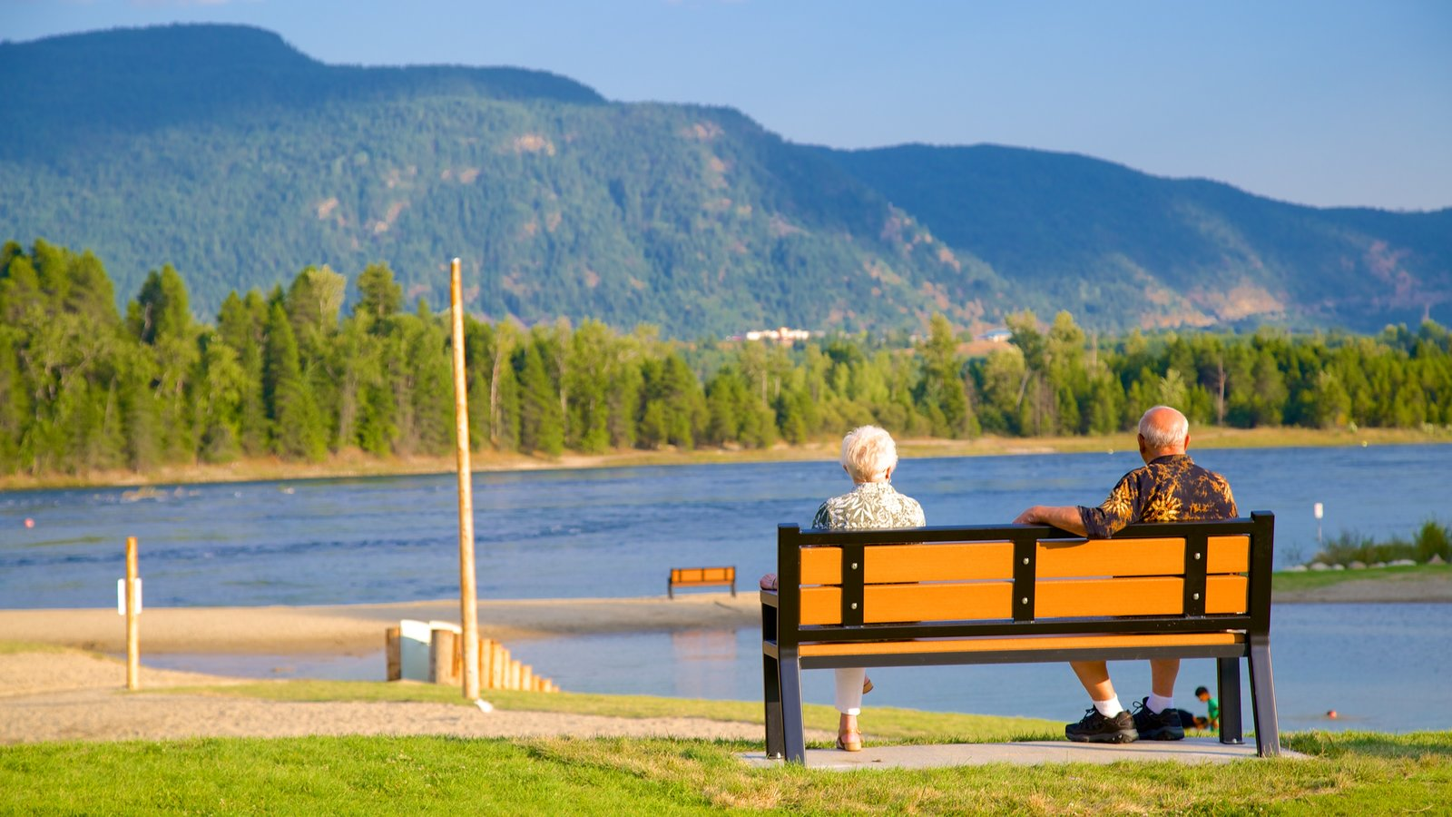 Castlegar featuring a river or creek as well as a couple