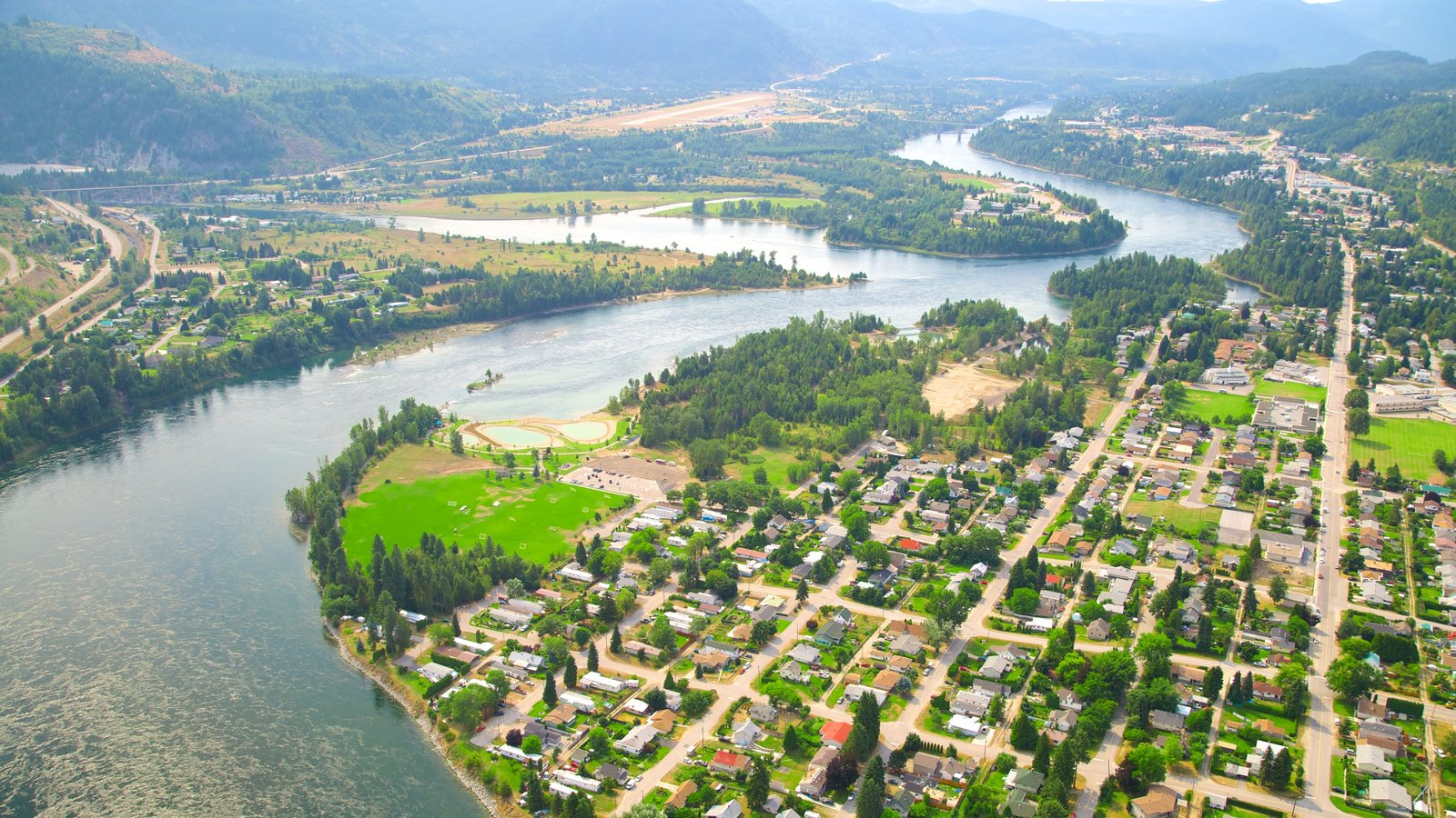 Castlegar featuring a river or creek, landscape views and a small town or village