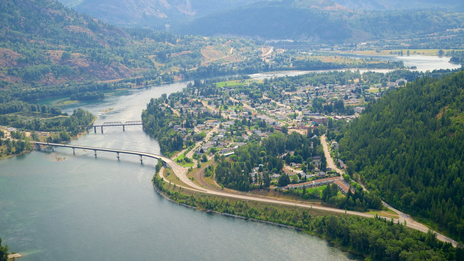 Castlegar which includes landscape views, a bridge and a small town or village