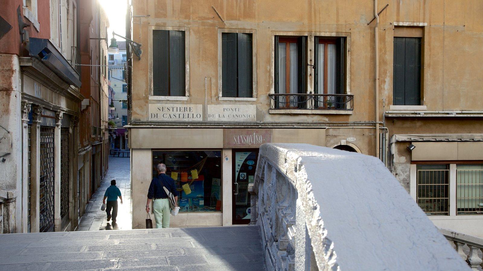 Castello which includes a bridge and heritage architecture