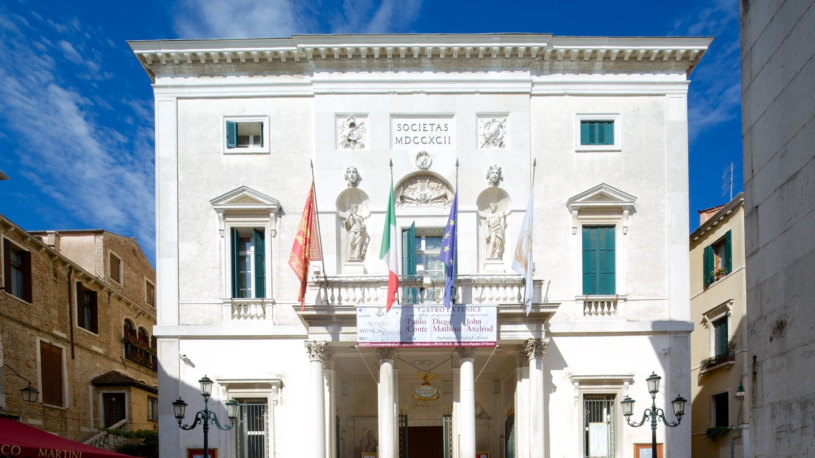 La Fenice Opera House showing heritage architecture and a city