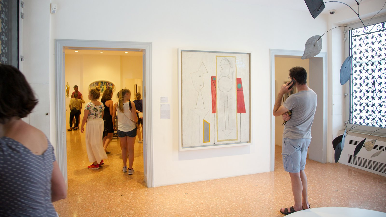 Peggy Guggenheim Museum featuring interior views and art as well as a small group of people