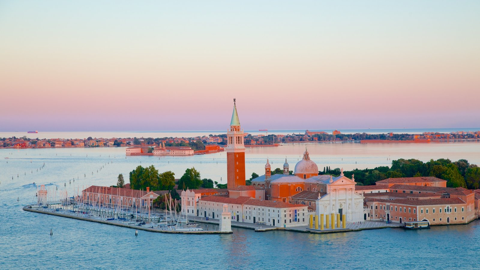St Mark\'s Campanile which includes a coastal town and a sunset