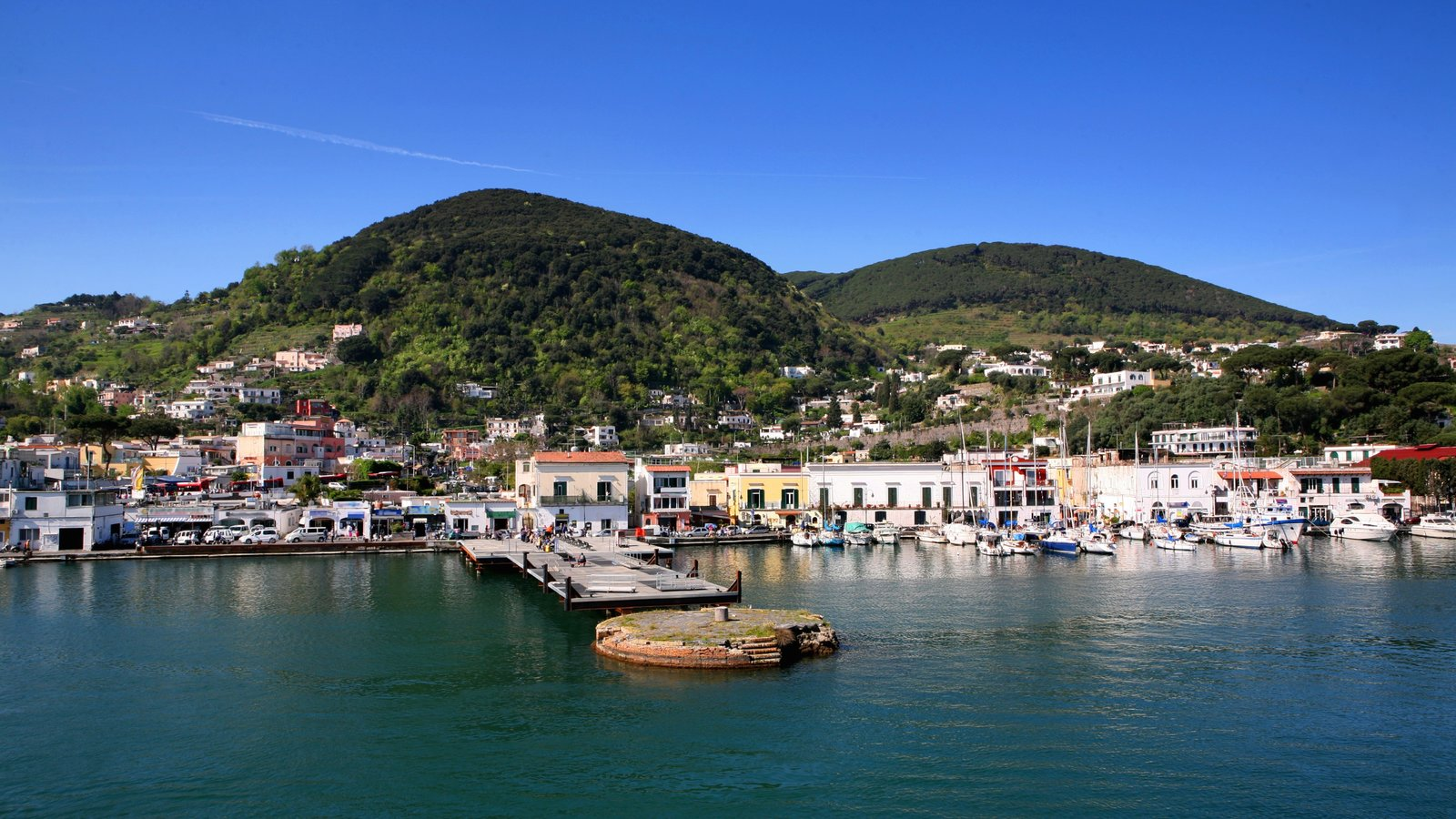 Ischia which includes a marina and a coastal town