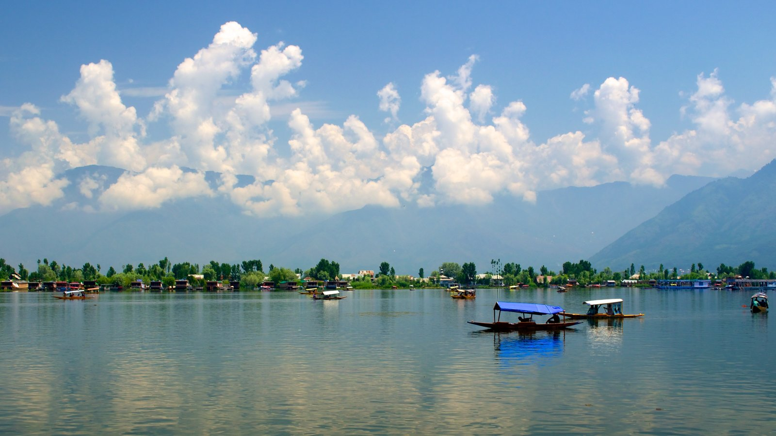 Srinagar which includes boating and a river or creek