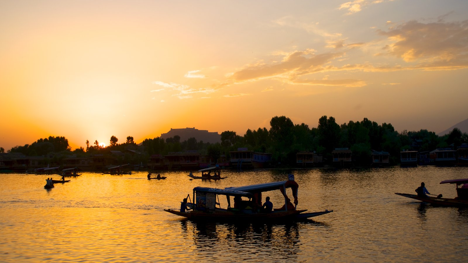 Srinagar showing a lake or waterhole, a sunset and boating