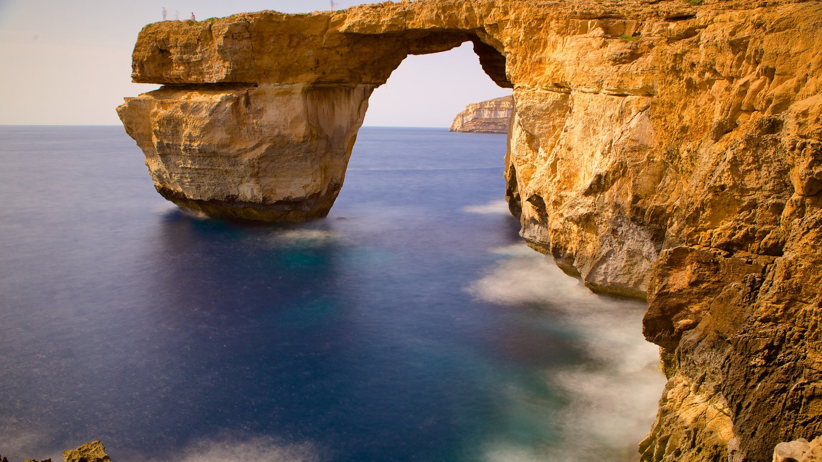 Azure Window which includes a sunset and rugged coastline