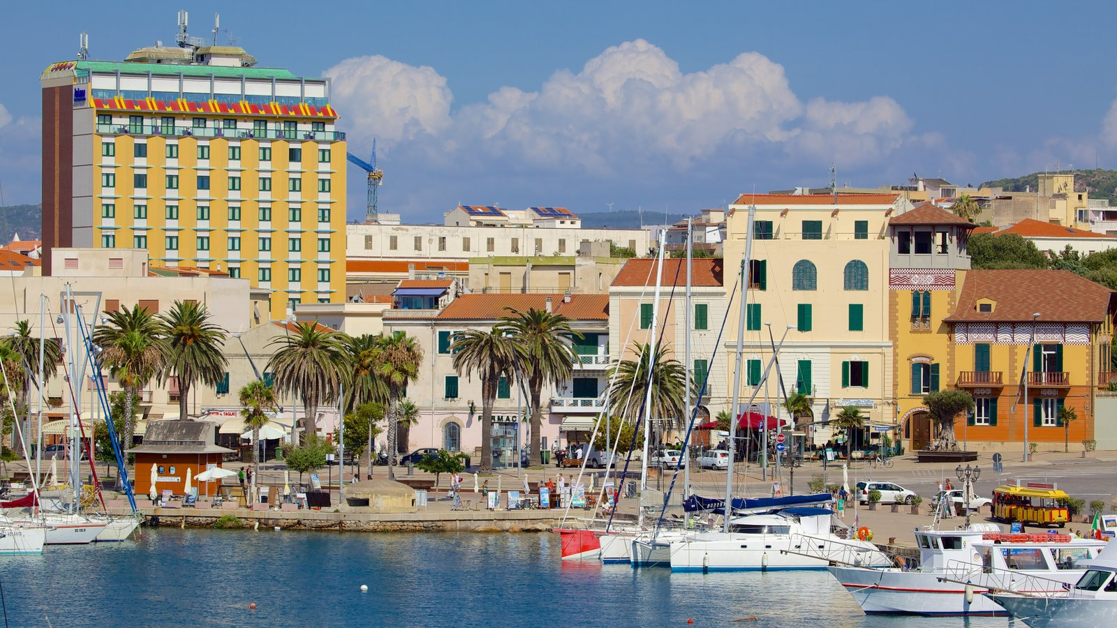Alghero - Northern Sardinia showing a coastal town and a marina