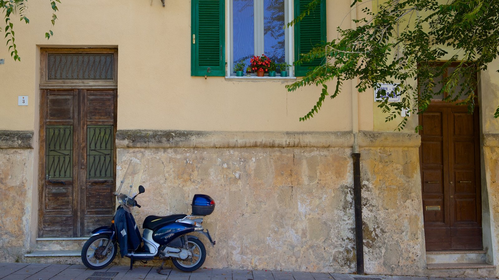 Alghero - Northern Sardinia which includes heritage architecture and a house