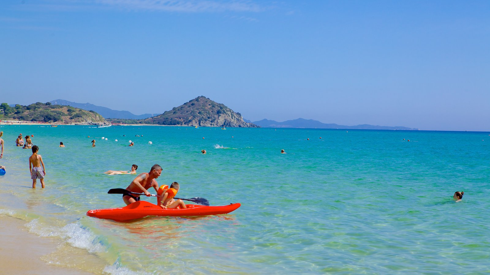 Cala Sinzias showing a beach and kayaking or canoeing