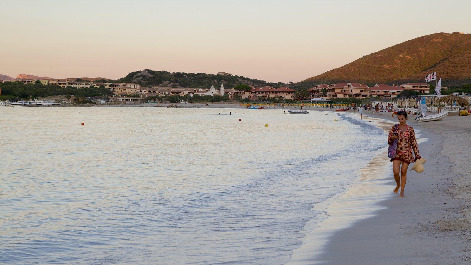 La Marinella Beach featuring a sunset, a beach and a coastal town