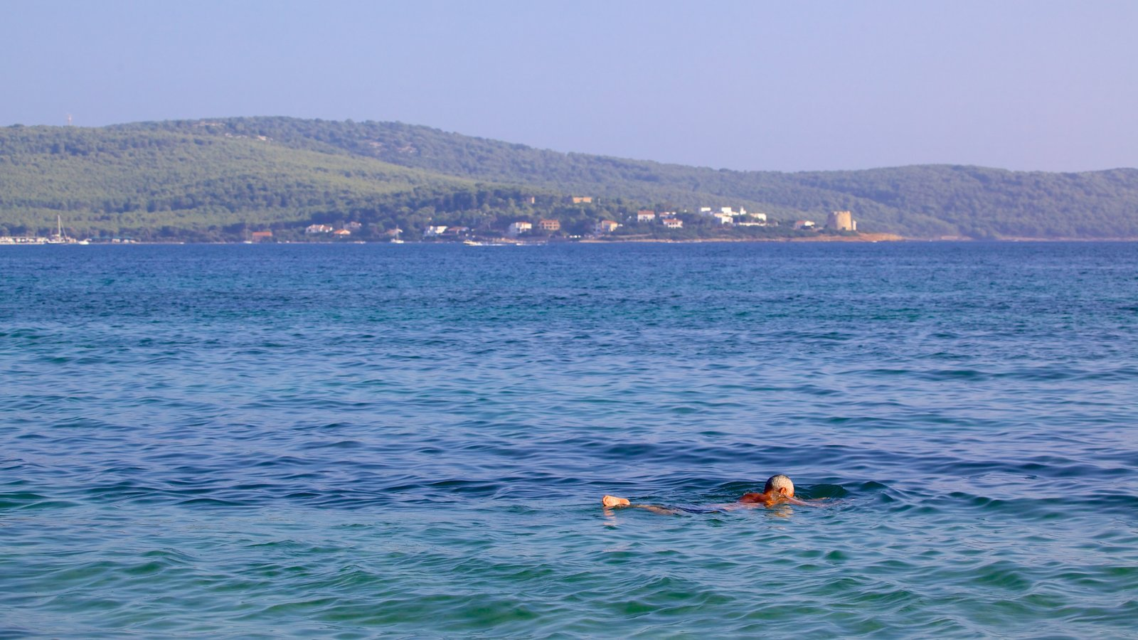 Mugoni Beach which includes swimming as well as an individual male