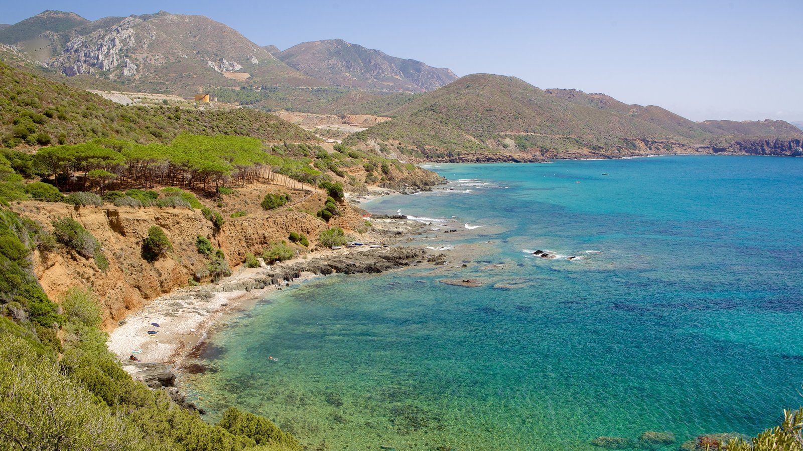 Porto Flavia featuring rugged coastline