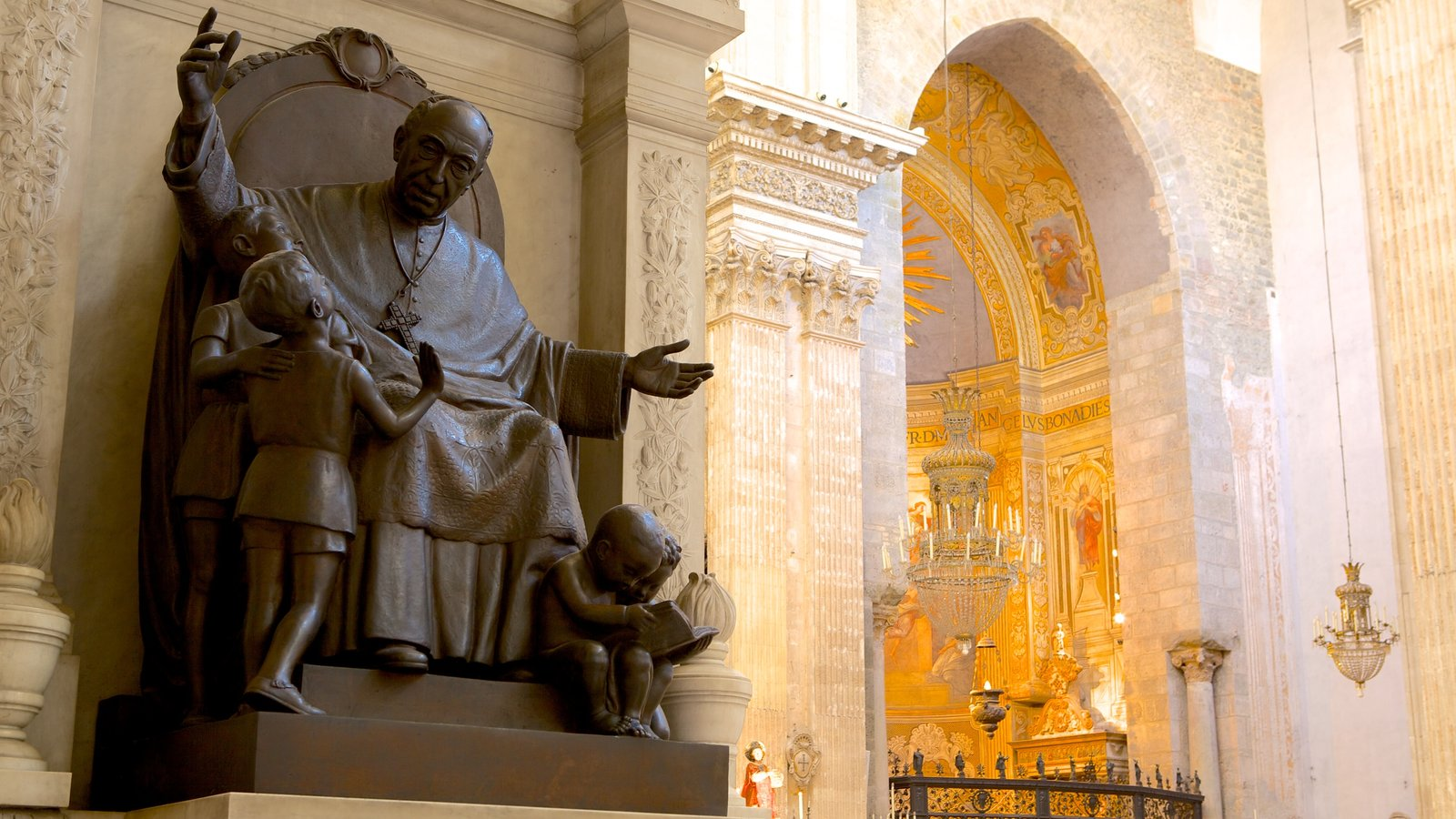 Catania Cathedral showing a statue or sculpture, interior views and a church or cathedral