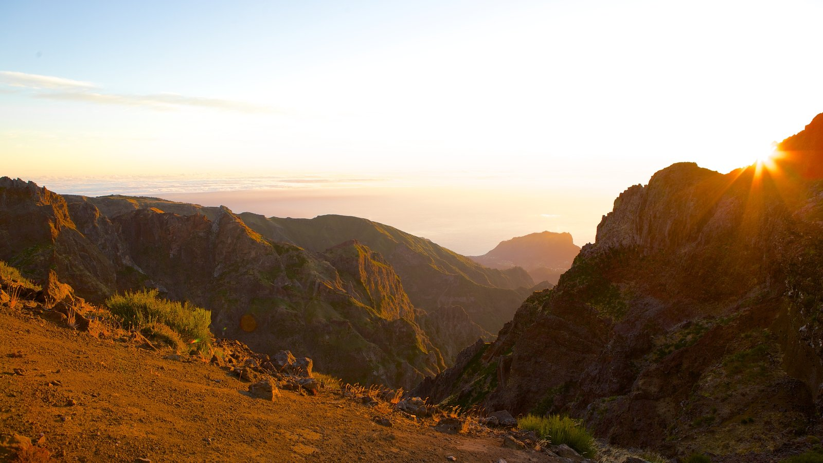 Pico do Ariero featuring a sunset and mountains