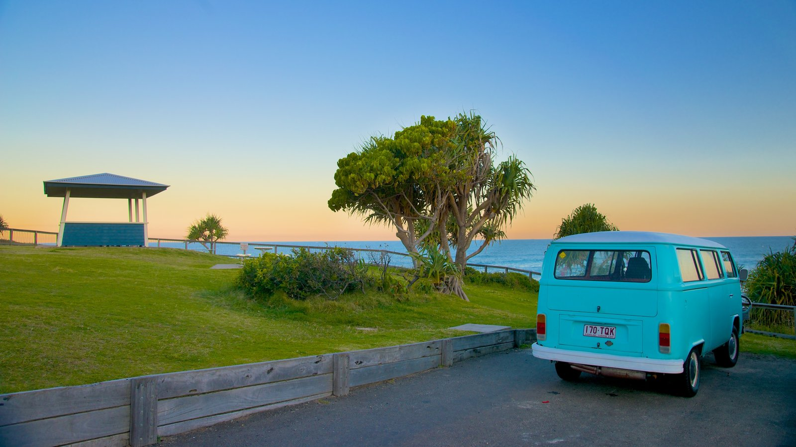 Coolum Beach which includes touring, a sunset and general coastal views