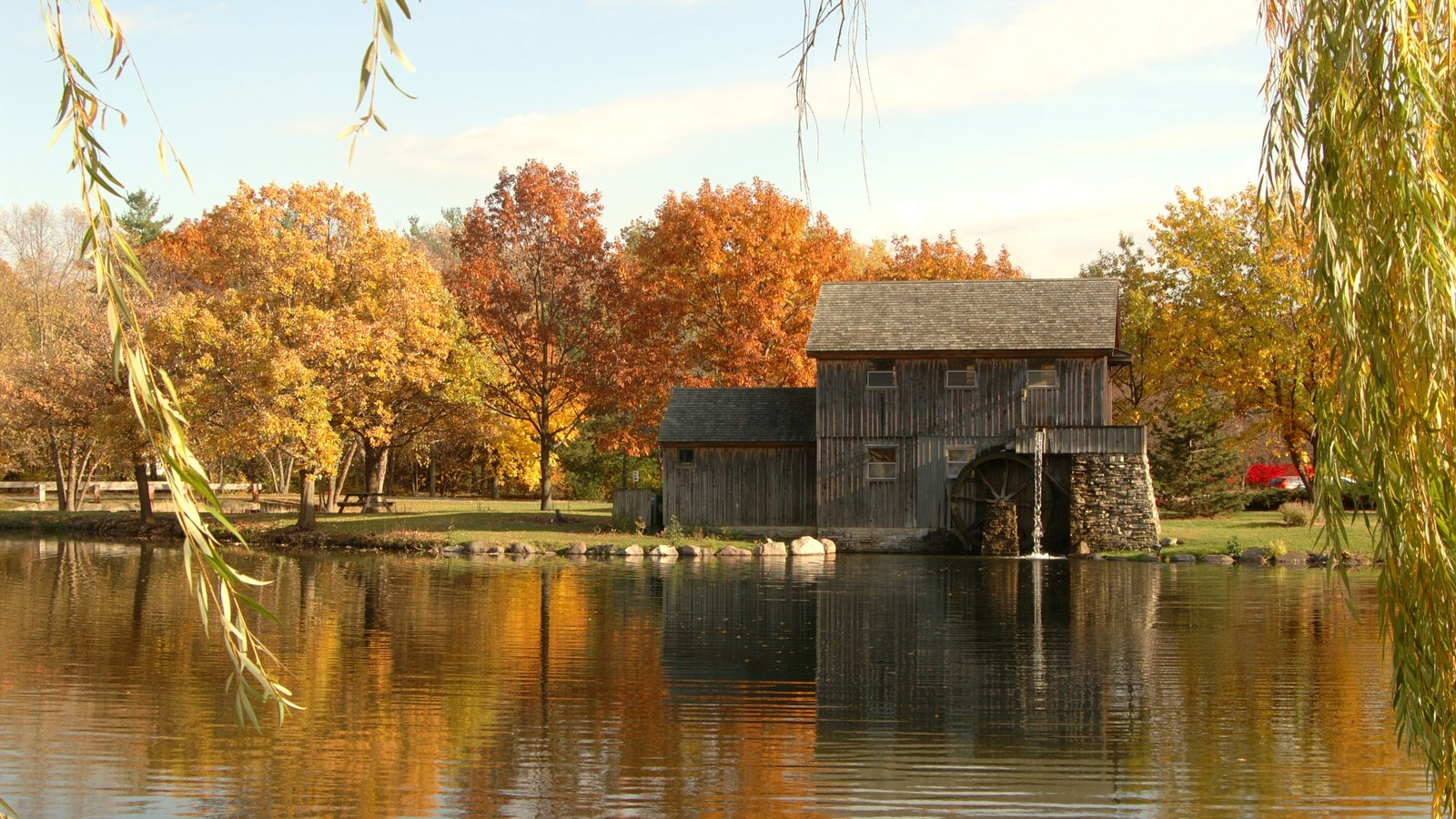 Rockford which includes a house, fall colors and a lake or waterhole