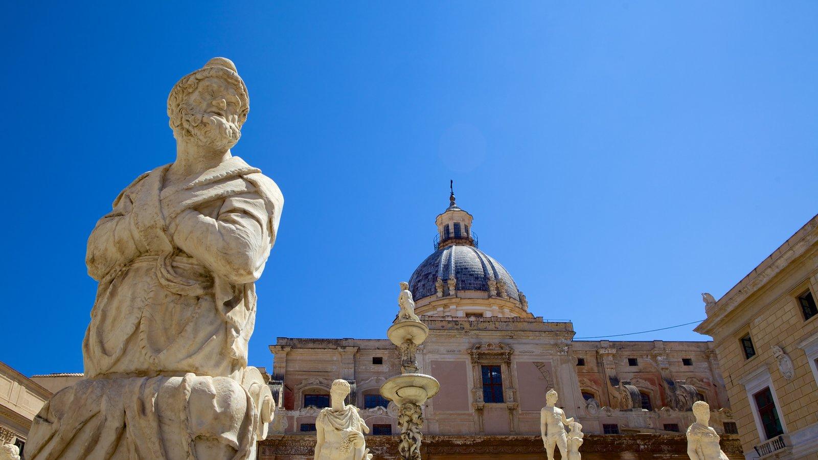 Via Maqueda mostrando elementos de patrimônio, uma estátua ou escultura e arquitetura de patrimônio