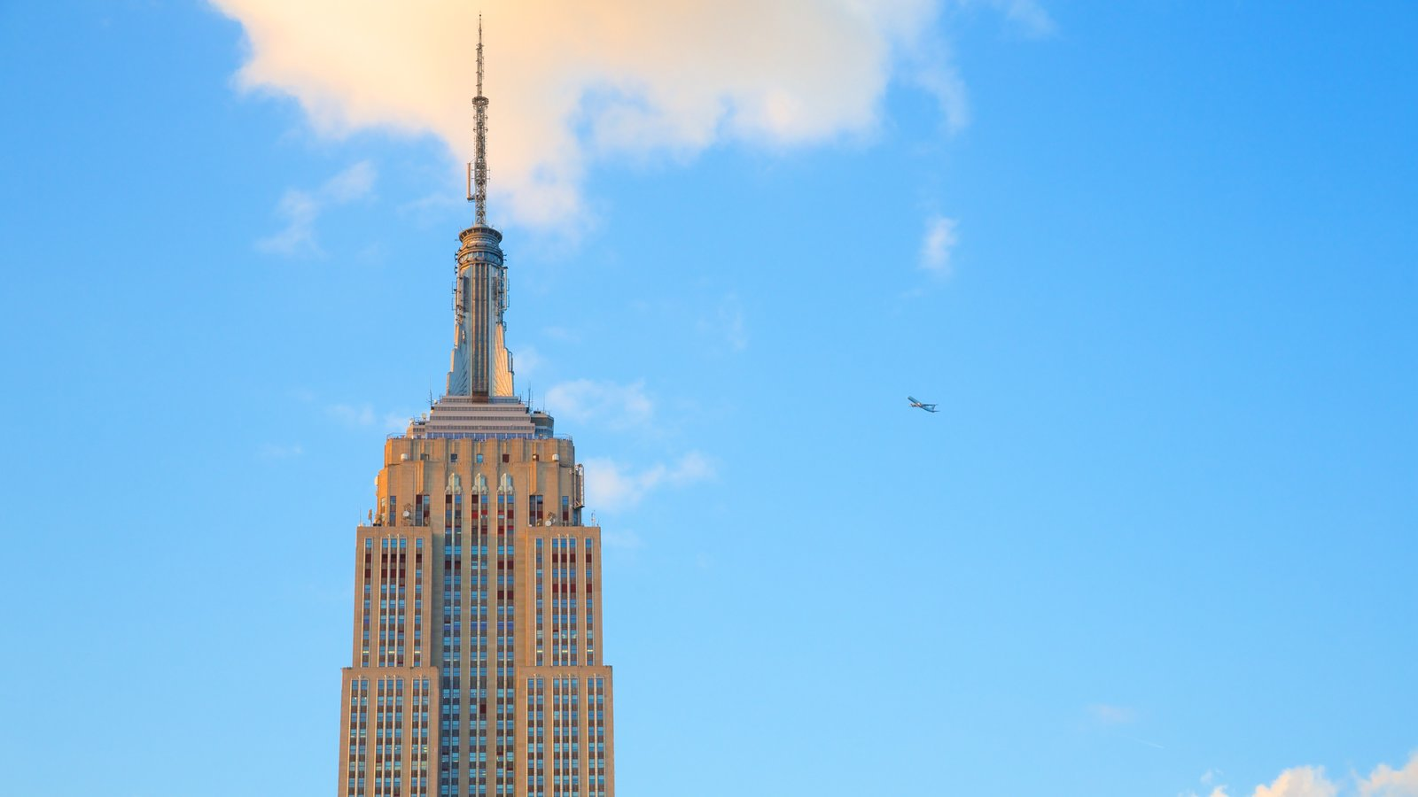Empire State Building which includes a skyscraper and a city