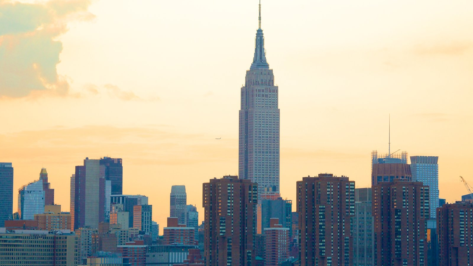 Empire State Building showing a city, a sunset and skyline