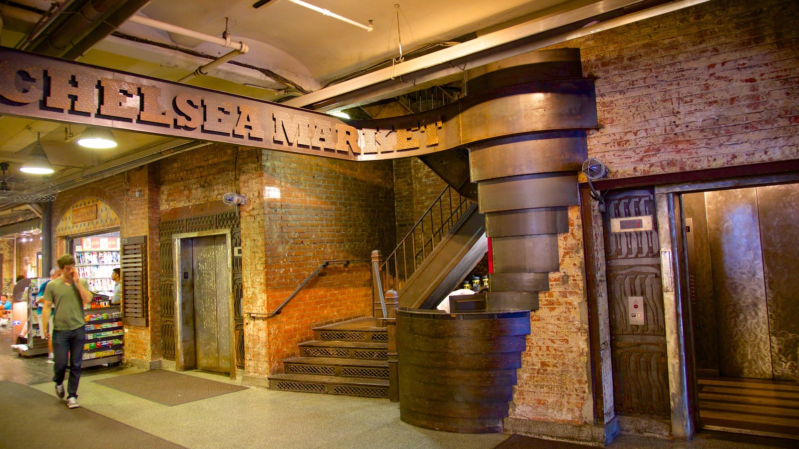Chelsea Market showing interior views, markets and signage