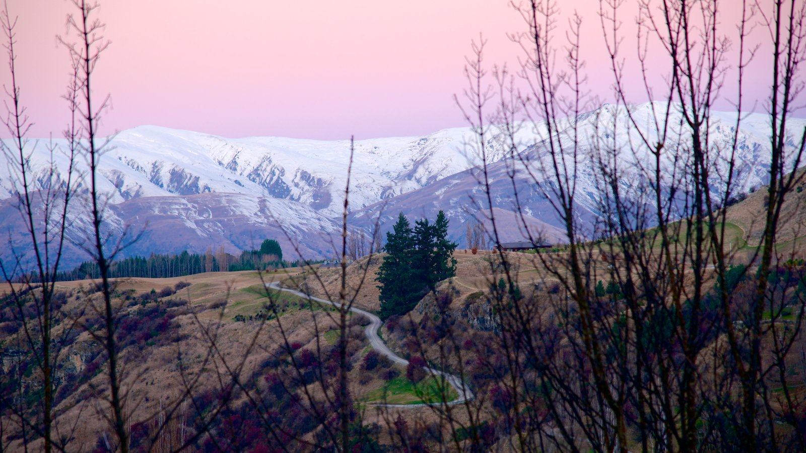 Queenstown showing tranquil scenes, snow and a sunset