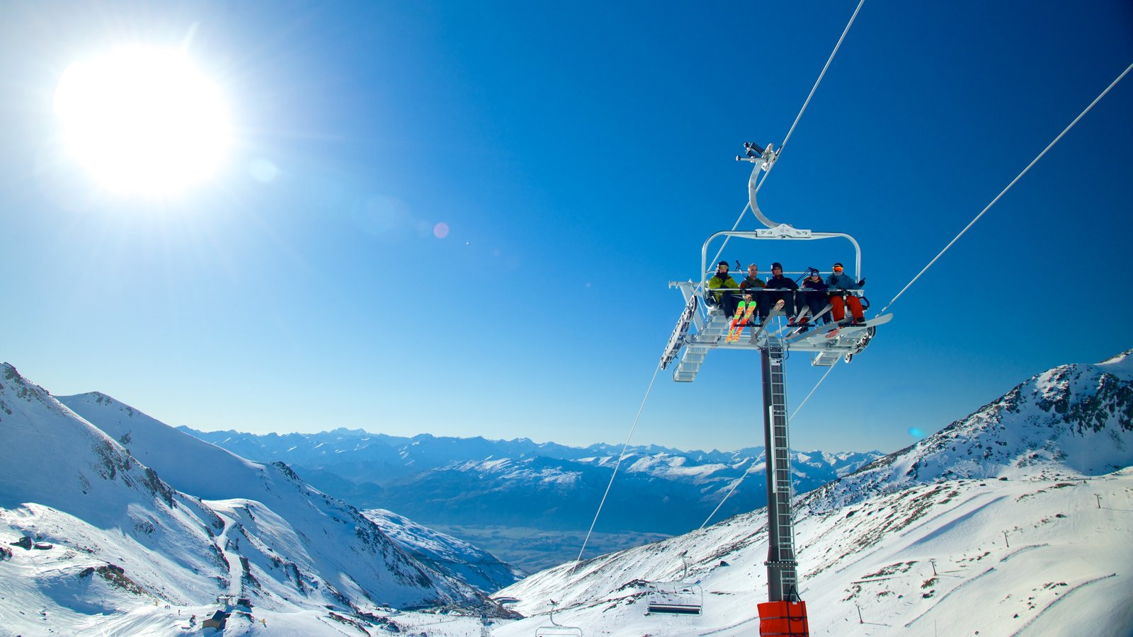 The Remarkables Ski Area showing a gondola and snow as well as a small group of people