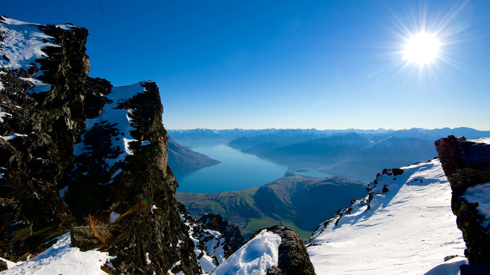 The Remarkables Ski Area which includes landscape views, snow and a river or creek
