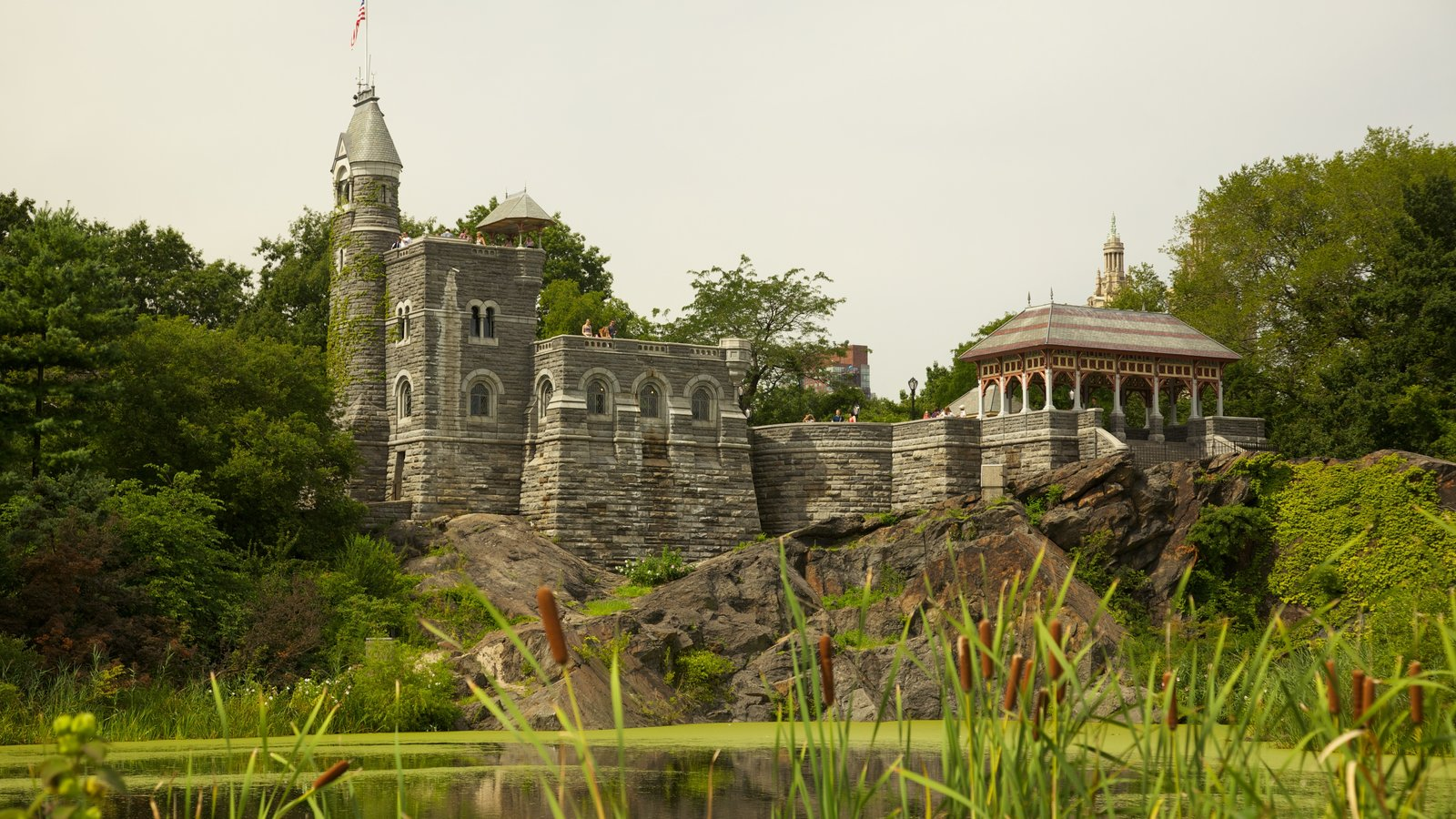 Belvedere Castle featuring a pond and a castle