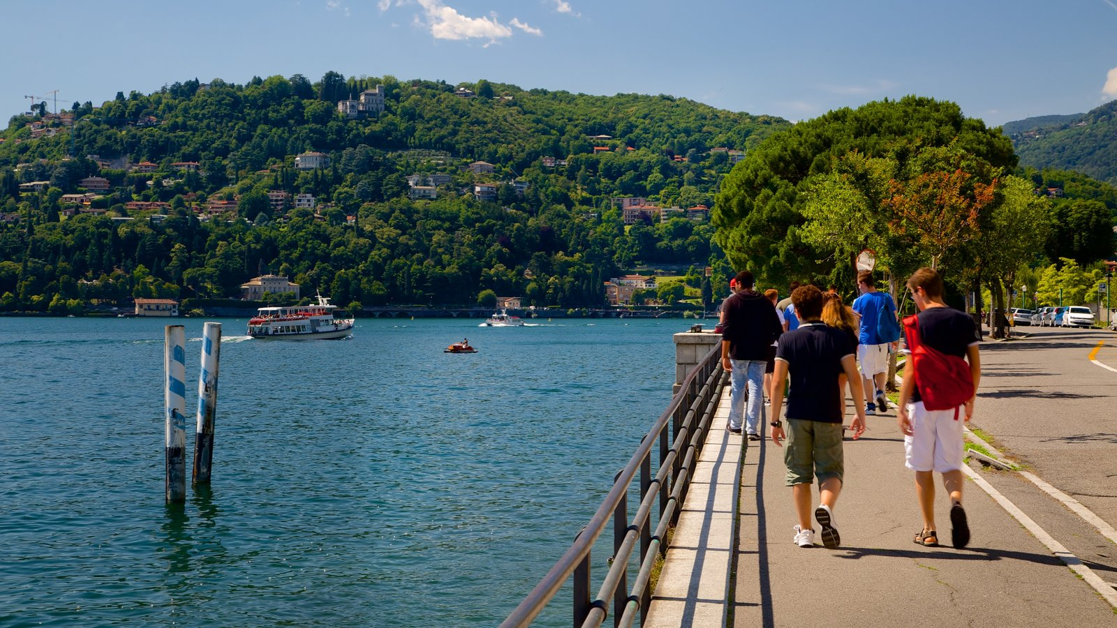 Como showing a coastal town and a bay or harbor as well as a small group of people