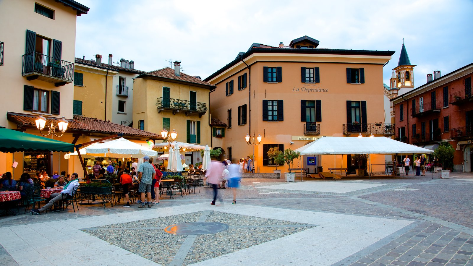 Menaggio showing outdoor eating as well as a small group of people