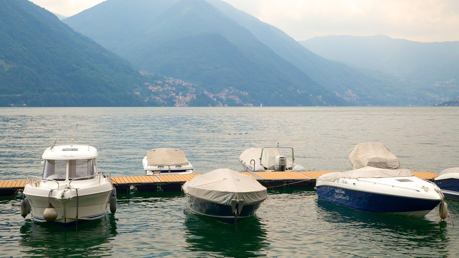 Argegno featuring a bay or harbor, general coastal views and boating