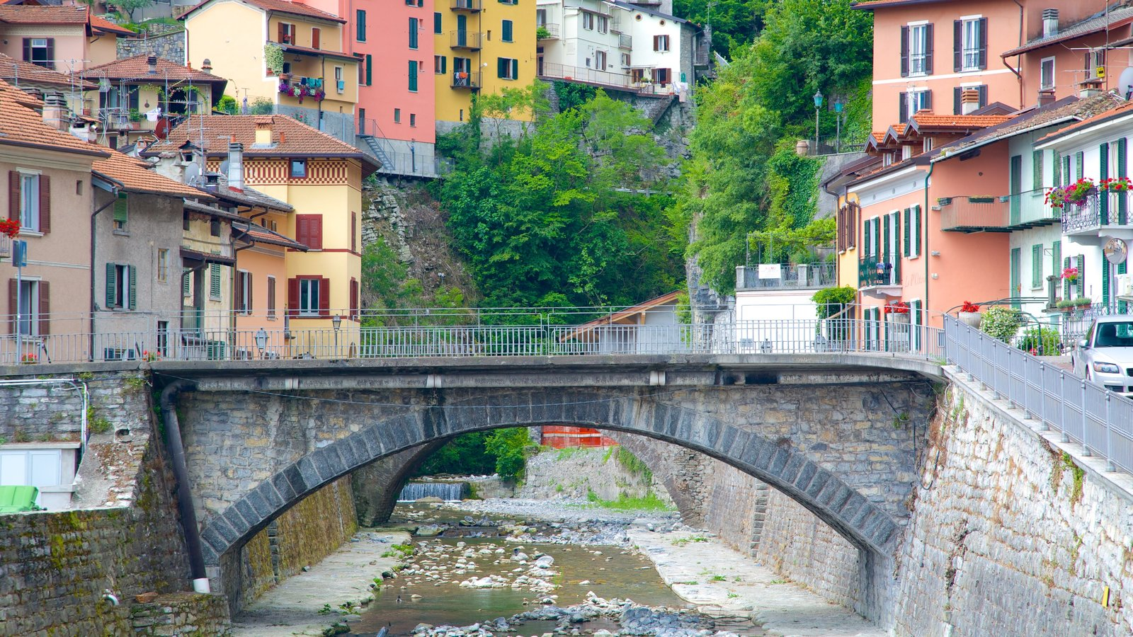 Argegno showing a river or creek, a small town or village and a bridge