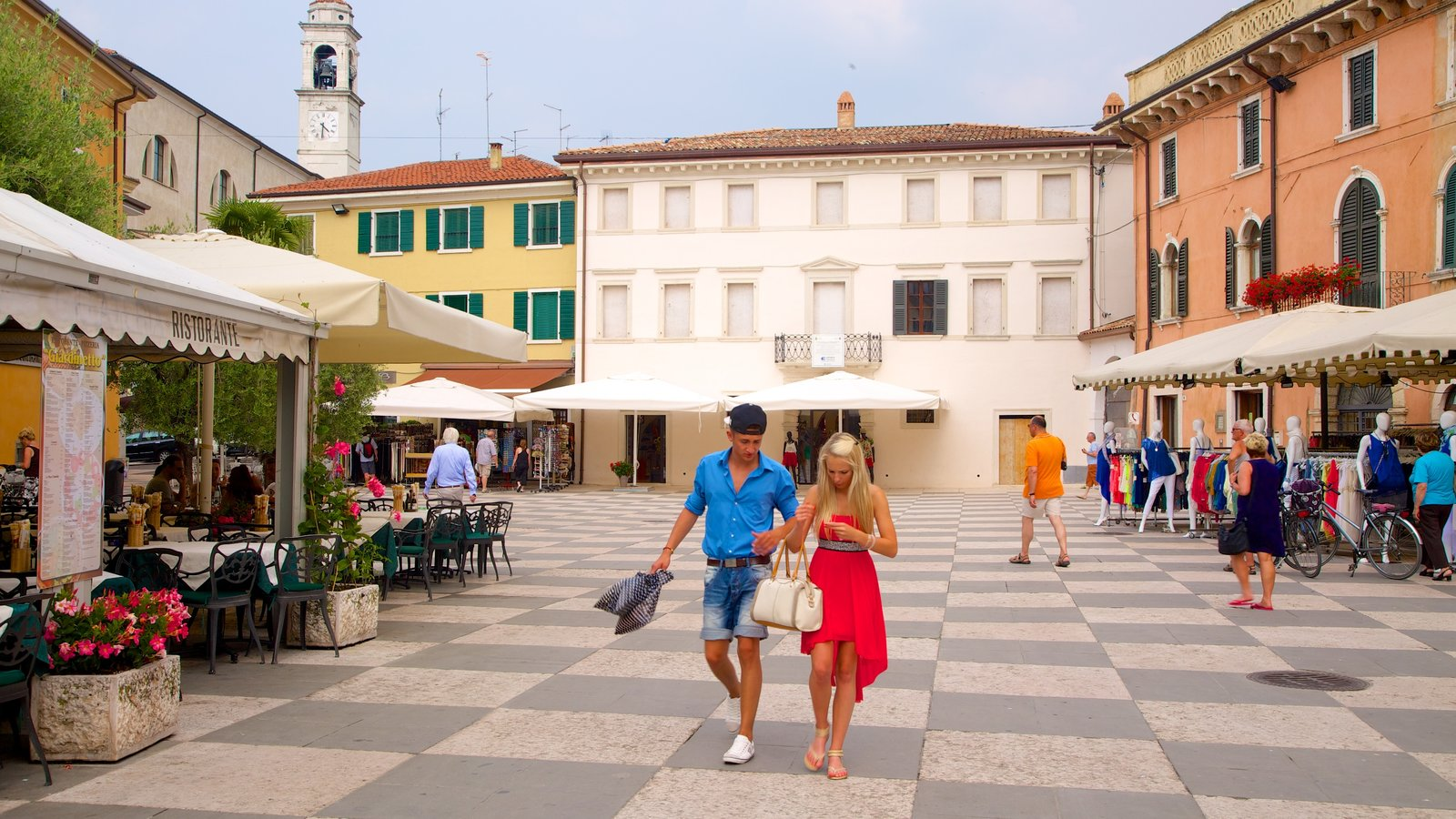 Lazise featuring a square or plaza and a city as well as a couple
