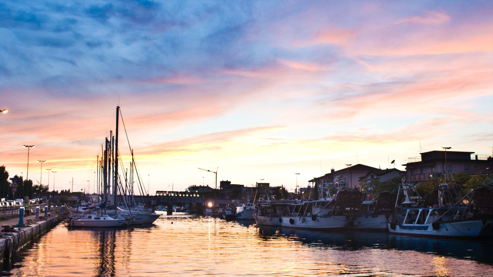 Bellaria-Igea Marina which includes a sunset, a bay or harbor and a city