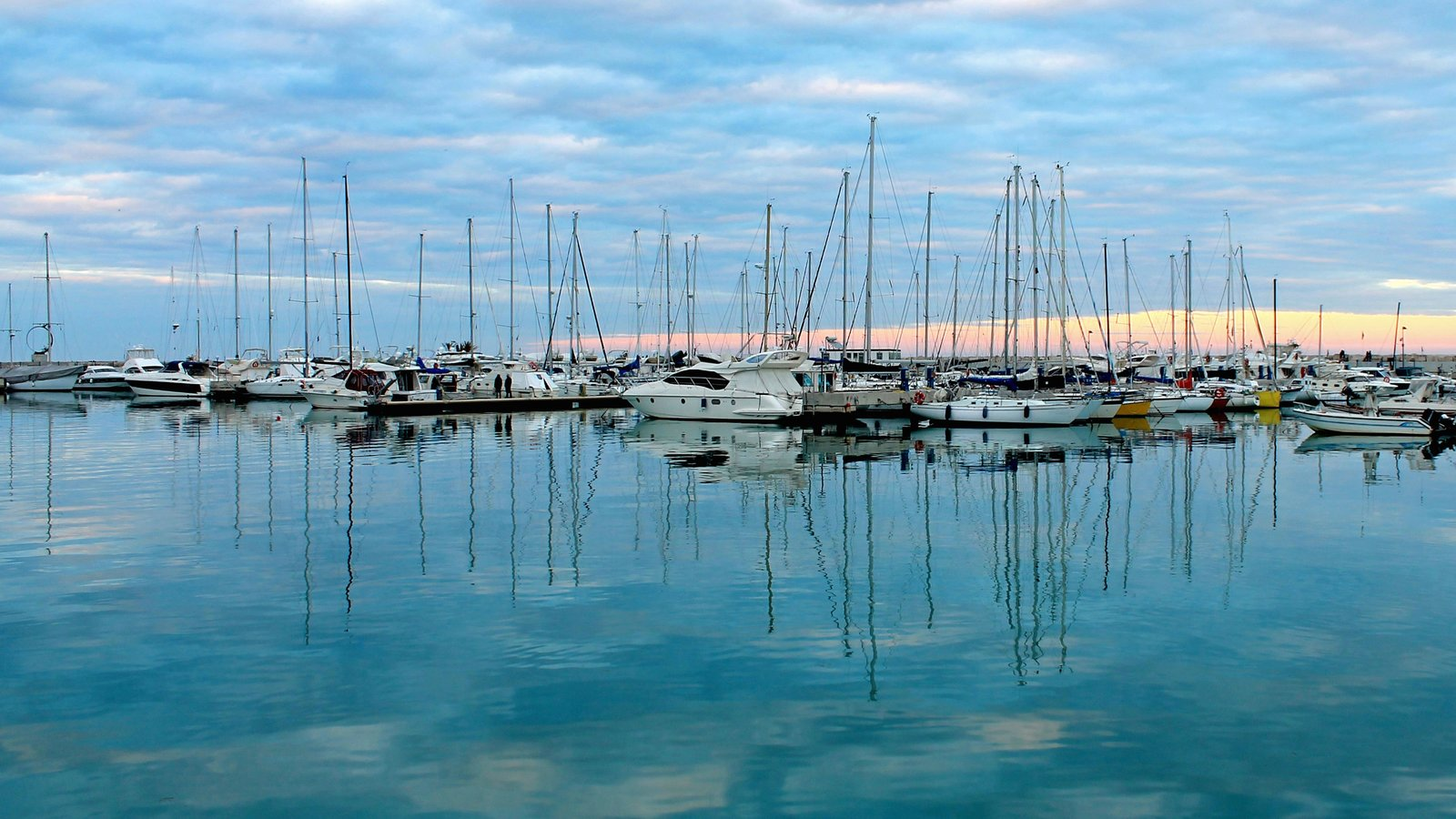 San Benedetto del Tronto which includes a sunset, general coastal views and a bay or harbor