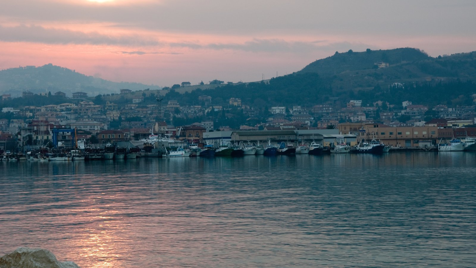 San Benedetto del Tronto which includes a coastal town, general coastal views and a sunset