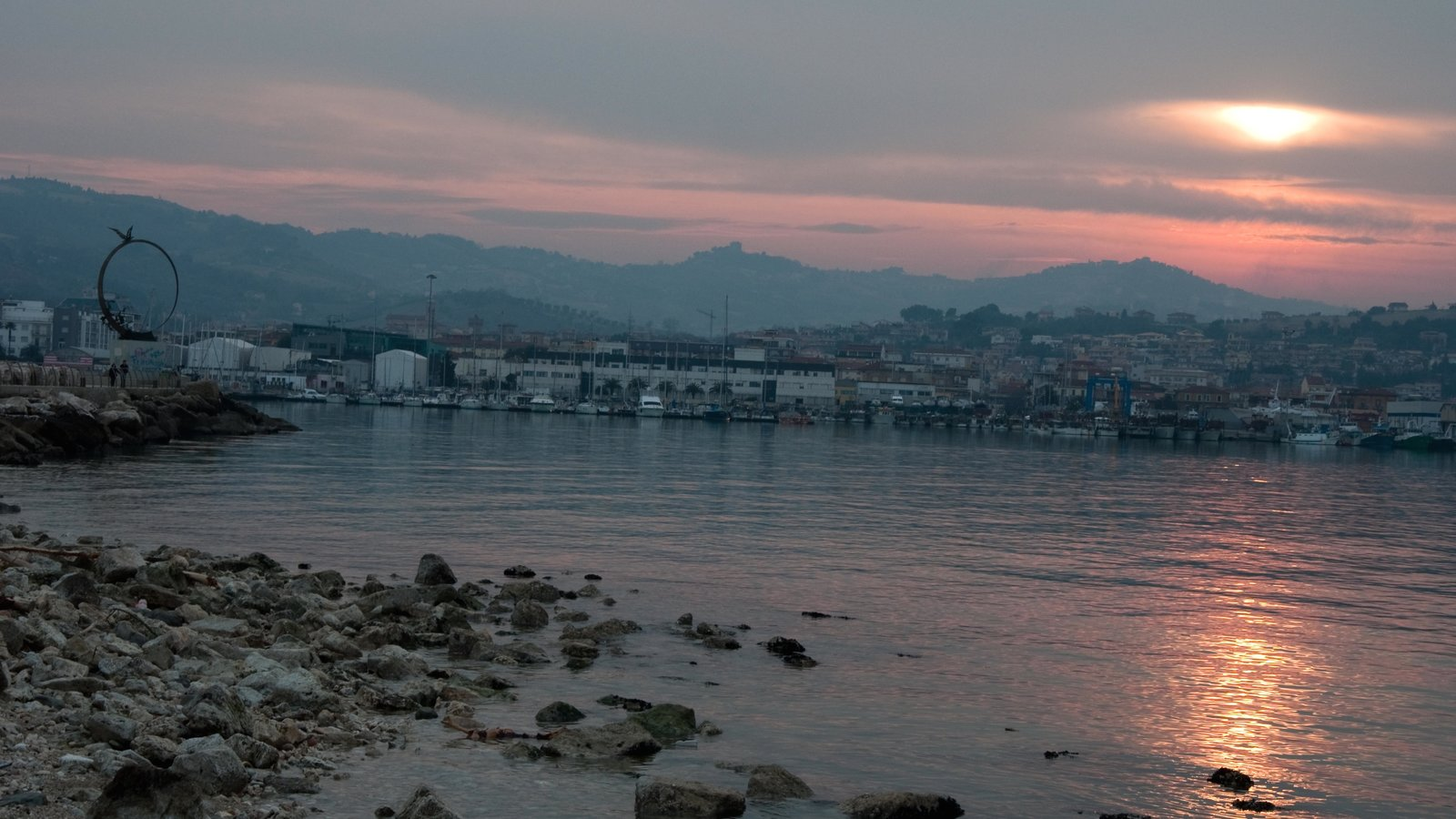 San Benedetto del Tronto showing a coastal town, a sunset and general coastal views