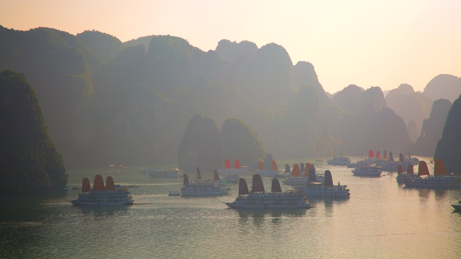 Halong Bay which includes a bay or harbor and mountains