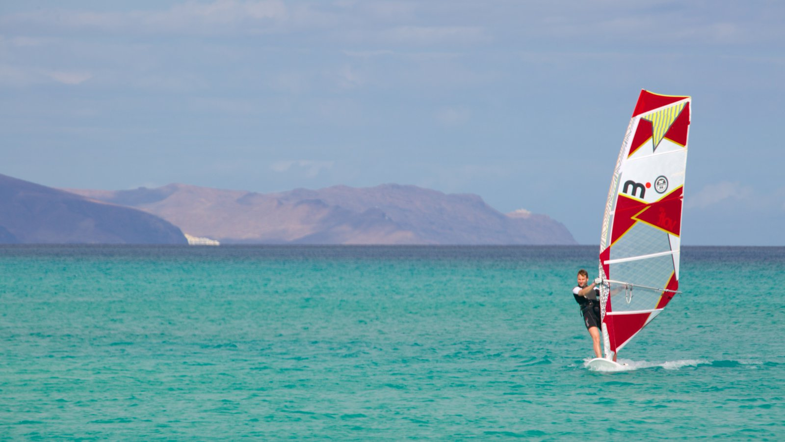 Sotavento de Jandia Beach featuring windsurfing and general coastal views as well as an individual male
