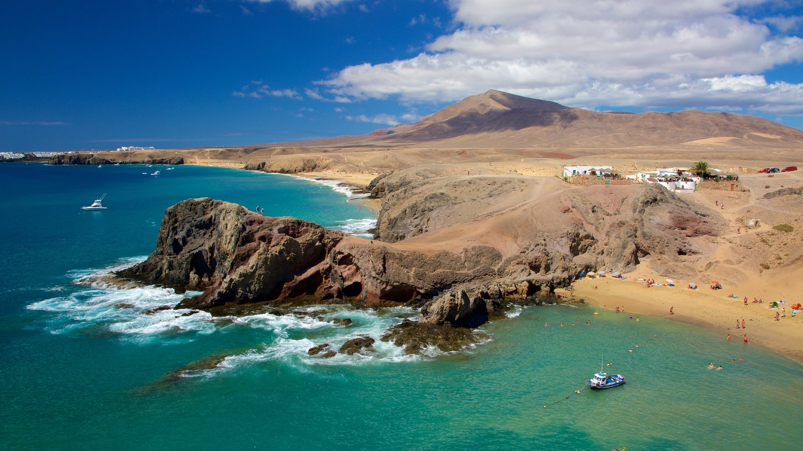 Papagayo Beach featuring boating, general coastal views and rocky coastline