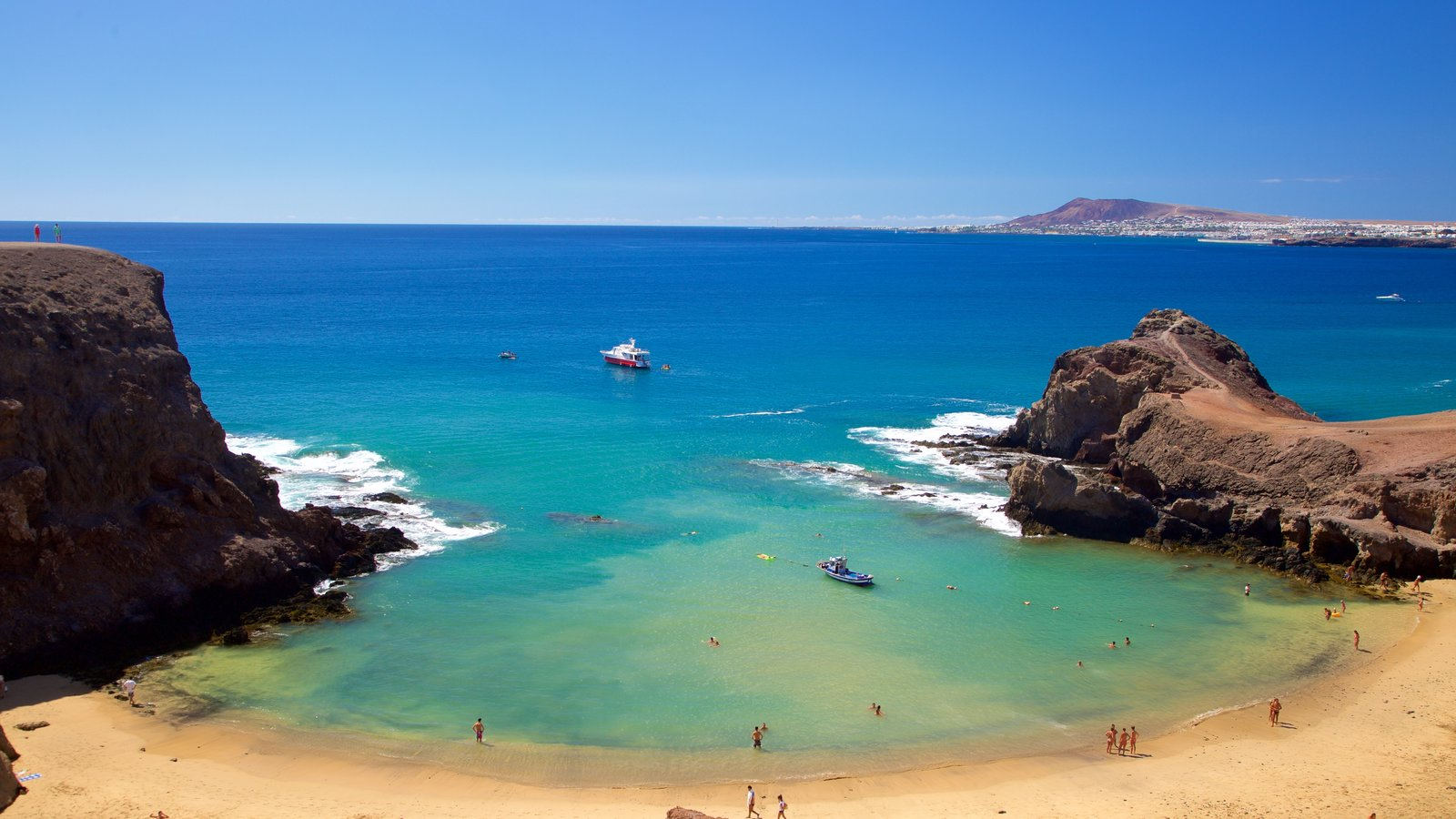 Papagayo Beach showing rugged coastline, general coastal views and a sandy beach